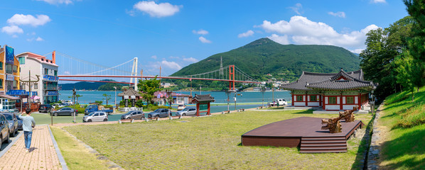 Chungnyeolsa shrine garden with Namhae Bridge and Yi Sun-sin turtle ship in Namhae County, South Gyeongsang Province Wall mural
