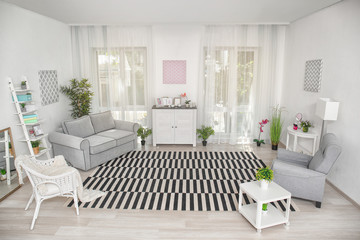 Modern living room design with big striped carpet
