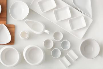 Set of ceramic tableware in kitchen drawer