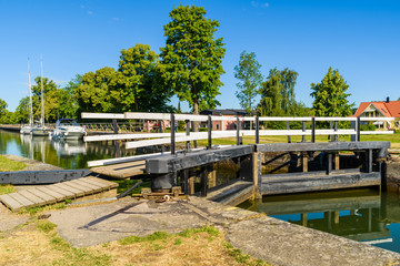 Closed canal lock with moored boats in the background. Location Berg, Sweden.