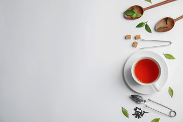 Flat lay composition with delicious tea on light background