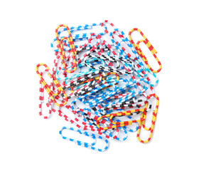 Heap of paper clips on white background. School stationery