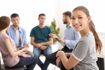 Young woman at group therapy session