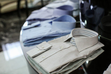 Classic men's shirts on shelf in boutique