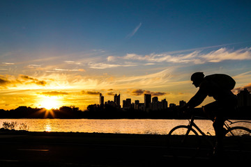 the boy on the bicycle on the sunset