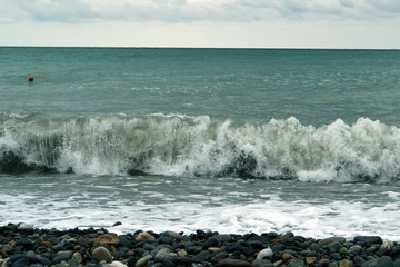 Breaking powerful waves at rising storm
