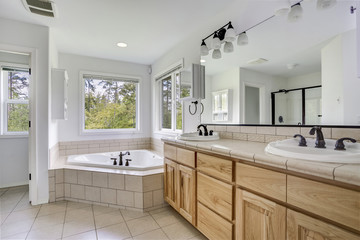 Master bathroom interior with dual vanity.