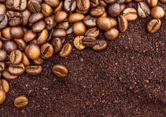 Background of ground coffee and coffee beans. Top view.