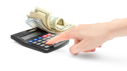 Woman's hand counts on the calculator and money on white background.