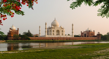 The Taj Mahal Mausoleum in Agra, India, seen from the other bank of the Yamuna river, near the Garden of the Moon, at sunset.