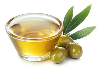 Bowl of olive oil and green olives with leaves Wall mural