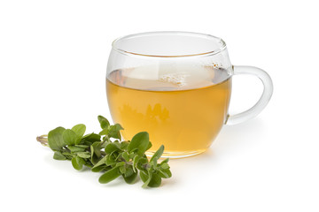Glass cup of marjoram tea