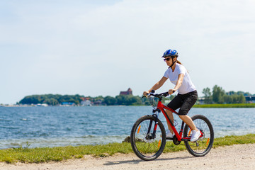 Healthy lifestyle - middle-aged woman riding bicycles