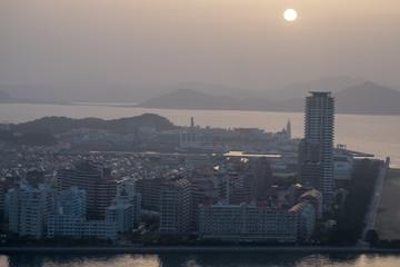 View of Kitakyushu City by the sea around Wakamatsu-ku in summer time.