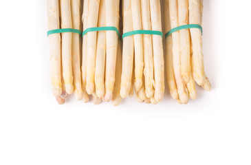 bundle of organic asparagus held together with green elastics rubber bands