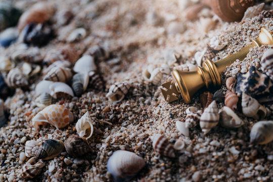 king chess board game sink in sand beach failuare business ideas concept
