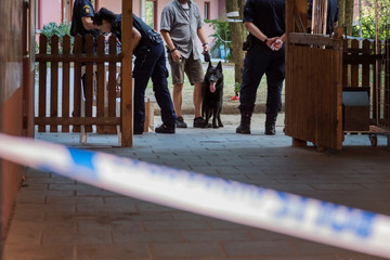 Police technicians search the site where a 20 year old man with Down Syndrome, who was carrying a toy gun that was mistaken for a real gun, was shot and killed by the police, in Stockholm
