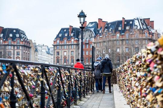 People watching the locks at Pont Neuf in Paris