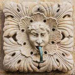 Dubrovnik, Croatia. Sculptural face on Onofrio's fountain
