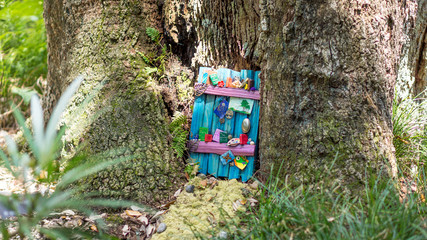 Decorated fairy door in a tree Wall mural