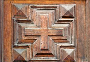 Carved cross on the door.