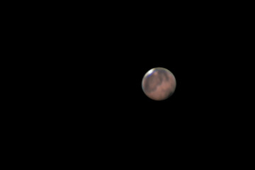 Mars in oppostion 2018, great view at long focal lenght taken with large newtonian telescope, isolated with dark background.