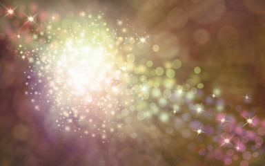 Elegant golden shimmering sparkles background - a white ball of sparkles with a stream of sparkles flowing top left to bottom right on a warm golden brown bokeh effect background