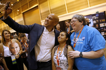 U.S. Senator Booker takes a picture with attendees at the Netroots Nation annual conference for political progressives in New Orleans