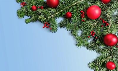 Christmas toys on fir tree branch
