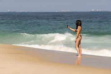 Young Woman Taking Picture at the Beach