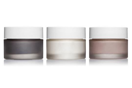Set of cosmetic cream jars, isolated on white background