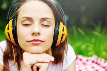 Enjoy the music, young woman in headphones
