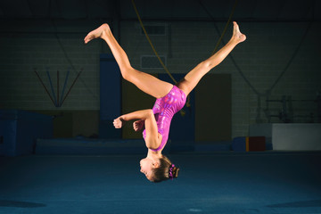 Female Child Gymnast Performs an Aerial