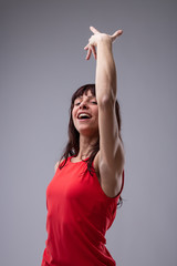 Attractive woman dancing and singing