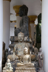 Battambang Cambodia, collection of sitting buddha statues