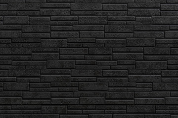 Black modern stone tile wall pattern and seamless background