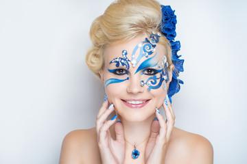 woman blue art make up