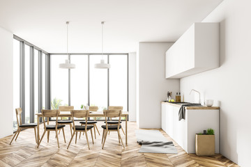 White dining room and kitchen interior