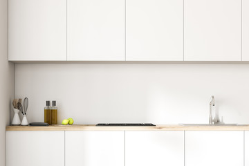 White kitchen countertops and closets close up