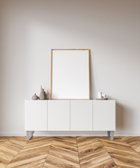 Vertical poster on white cabinet