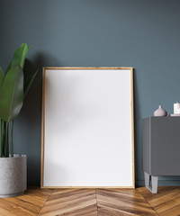 Vertical poster in empty gray room