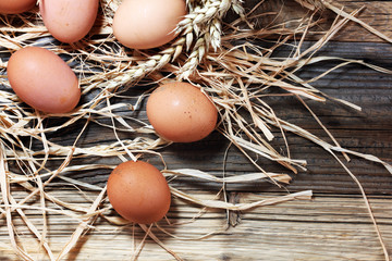 Egg. Fresh farm eggs on a wooden rustic background