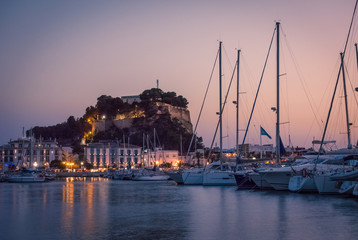 Denia Marina at sunset, with the famous medieval castle on the background. Alicante, Spain.