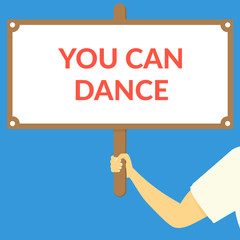 YOU CAN DANCE. Hand holding wooden sign