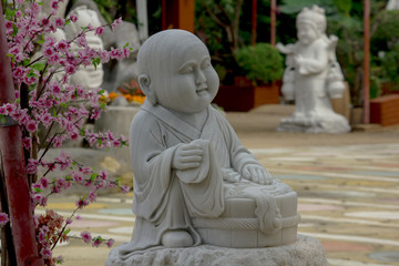 Statue carved from marble in Chinese style.