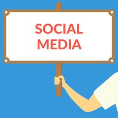SOCIAL MEDIA. Hand holding wooden sign