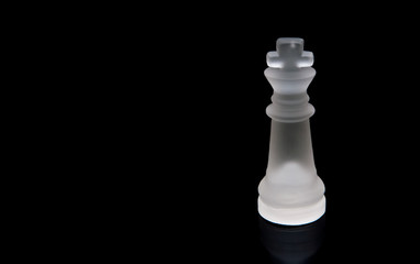glass chess. white king on a black