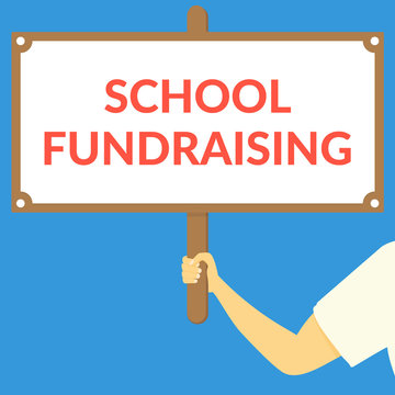 SCHOOL FUNDRAISING. Hand holding wooden sign