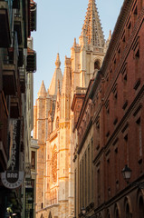 Gothic Cathedral of Leon, Castilla y Leon (Spain), during sunset. It views from one of the adjacent streets. Summer of 2017.