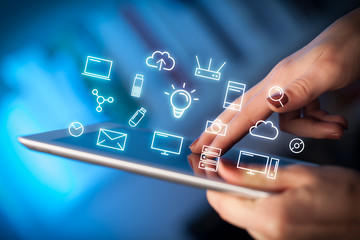Female hands touching tablet with white technology related icons